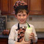 boy holding powerhouse protein smoothie