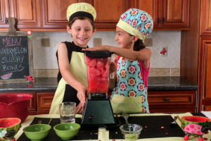 kids having fun making watermelon slushie bowls