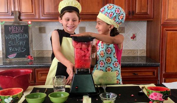 kids having fun making watermelon slushie bowls