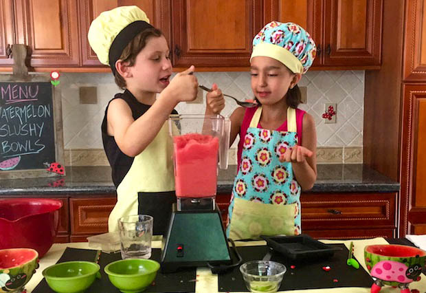 watermelon slushy bowl with kids eating