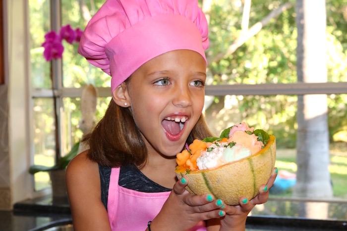 cantaloupe treat bowl girl holding bowl
