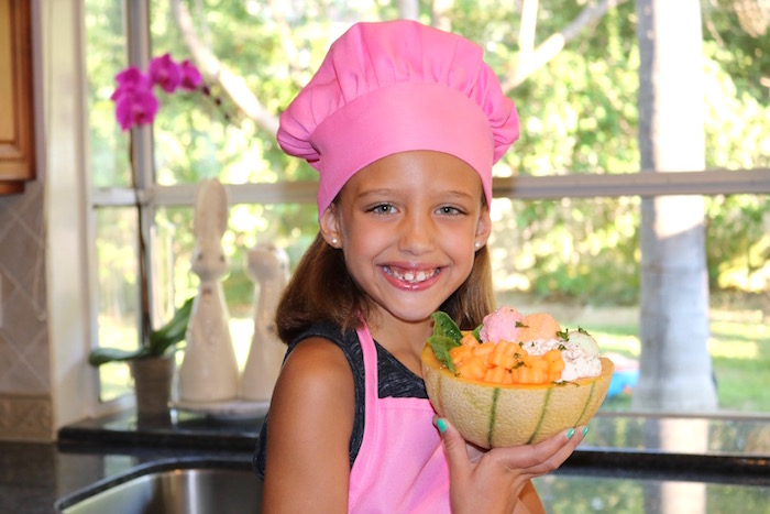 cantaloupe treat bowl with girl