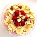 raspberry smoothie bowl with toppings