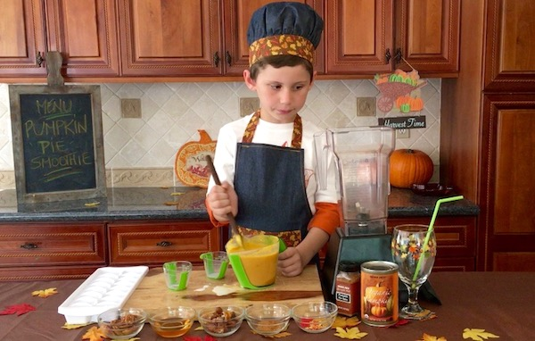 boy stirring pumpkin