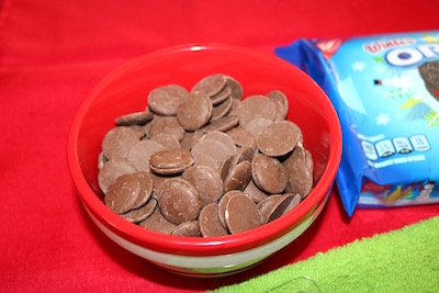 milk chocolate discs in a bowl