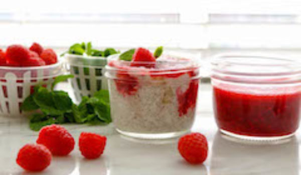 banana chia seed pudding with raspberry sauce feature image