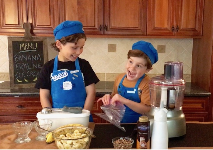 boys-laughing making banana ice cream