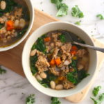 chicken sausage soup white bean and kale soup on board