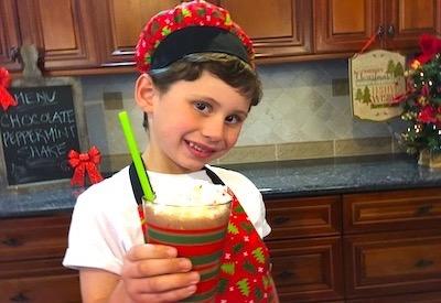 boy holding chocolate peppermint shake