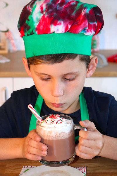 candy cane cocoa recipe with boy