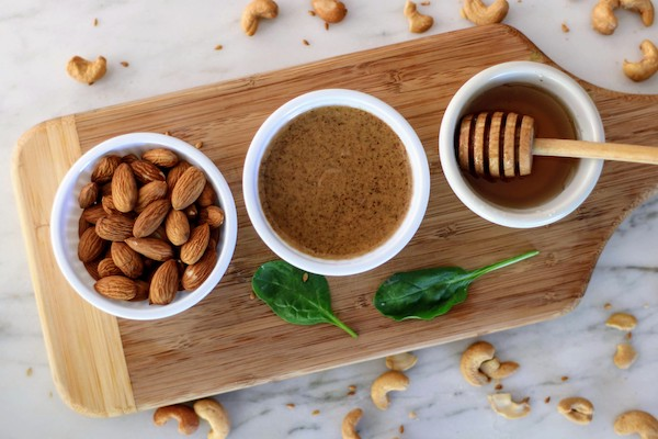 almonds almond butter and honey in cups