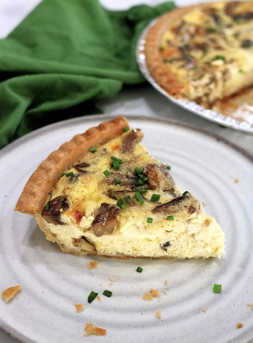 slice cheese and mushroom quiche